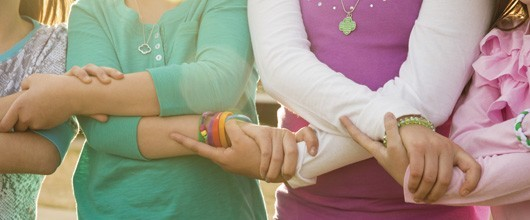Girl Scout members holding hands